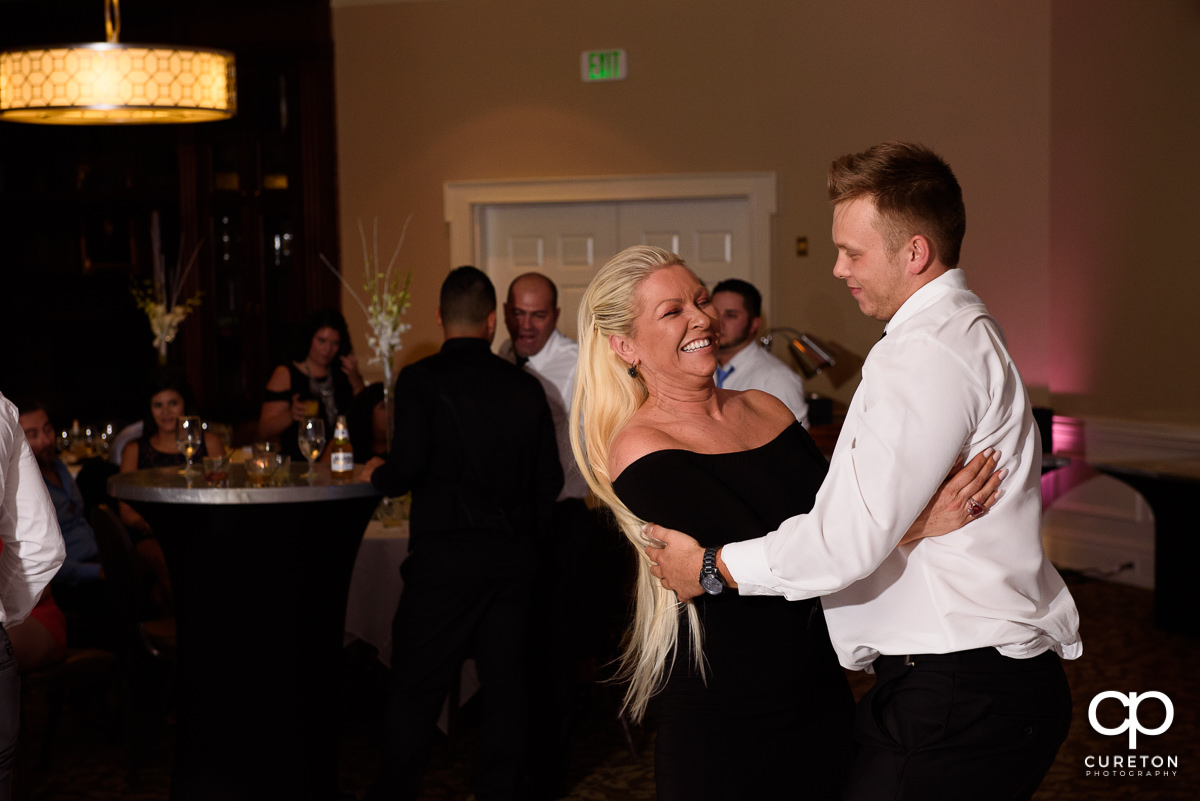 Bride's mom dancing with her son.