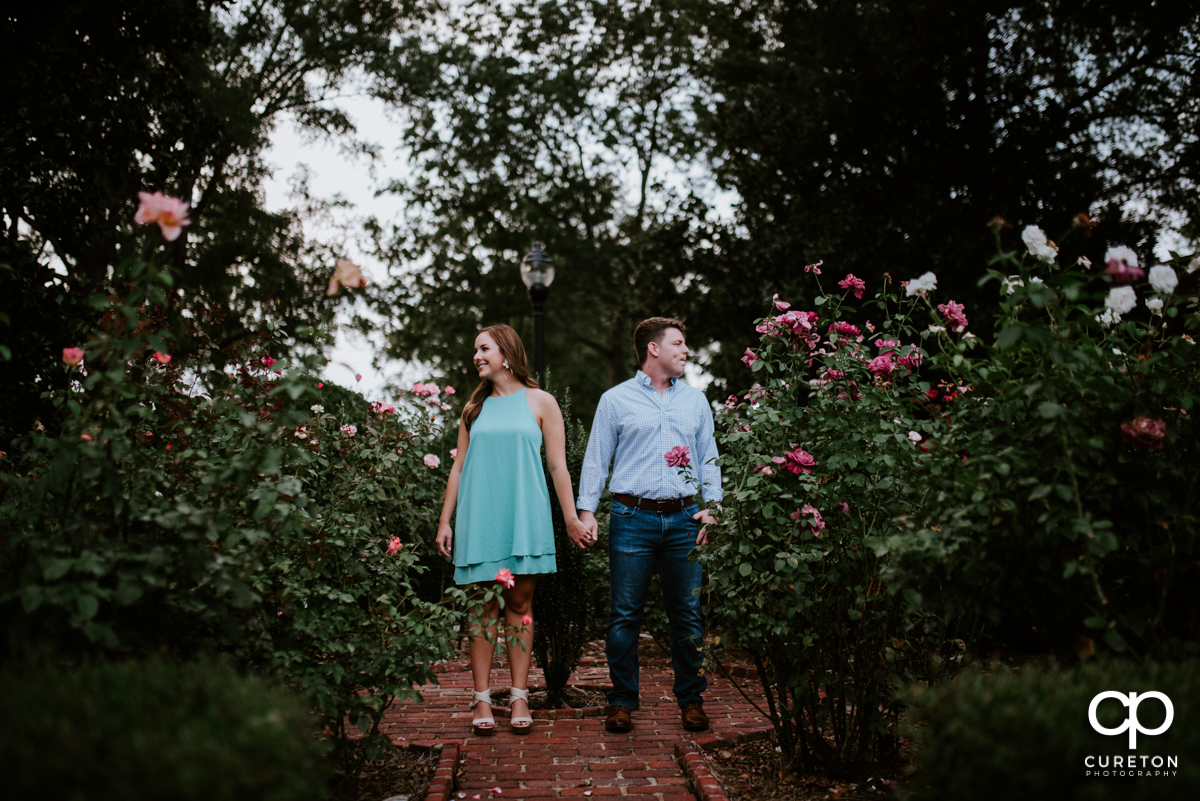 Couple hanging out in the rose garden at Furman University.