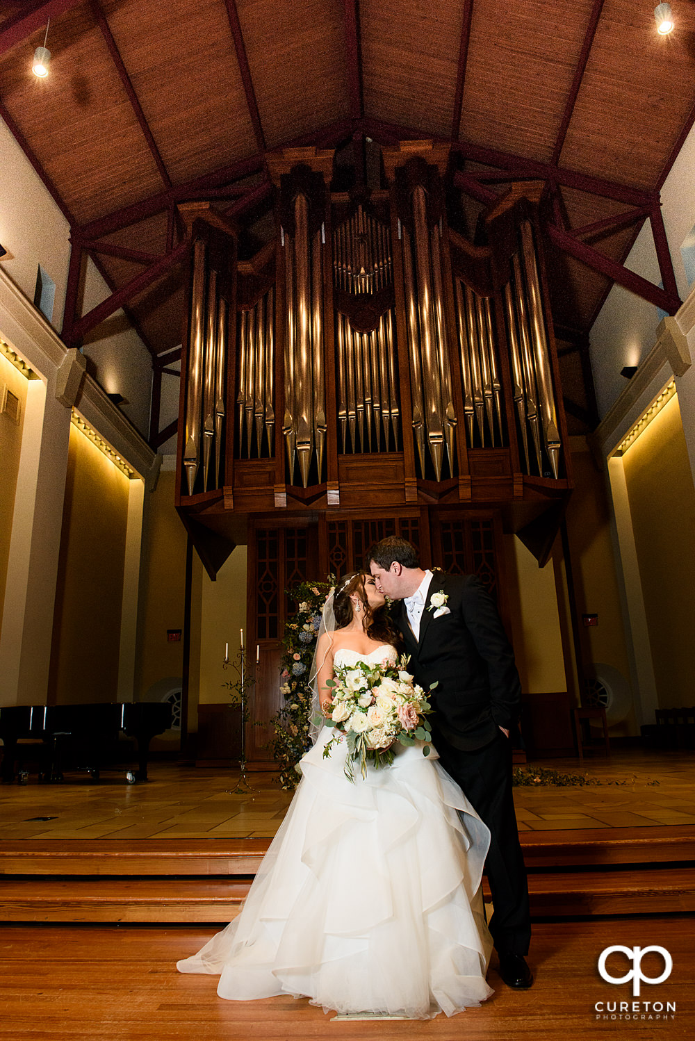 Couple kissing after their wedding at Daniel Chapel.