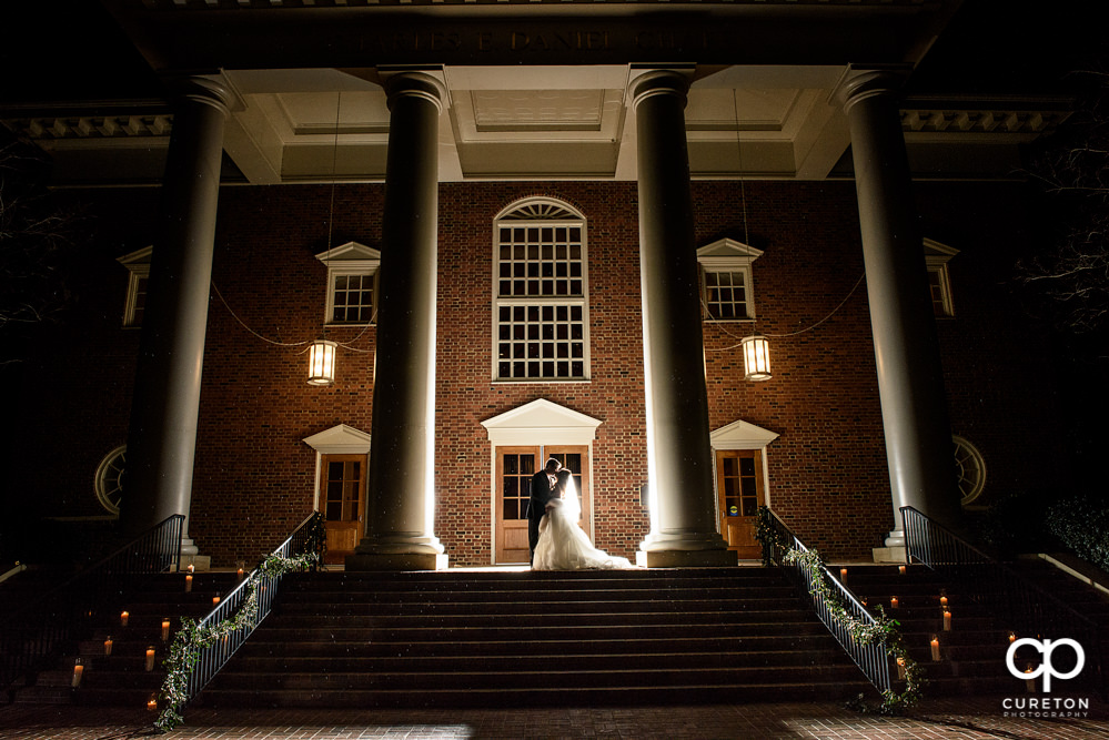 Gorgeous back with photo of a bride and groom in front of Daniel chapel on the Furman university campus in Greenville South Carolina after their wedding.