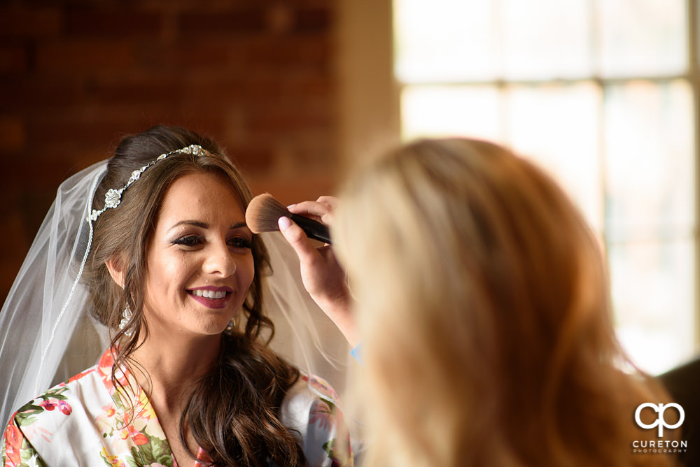 Bride getting her makeup done at Soby's loft.
