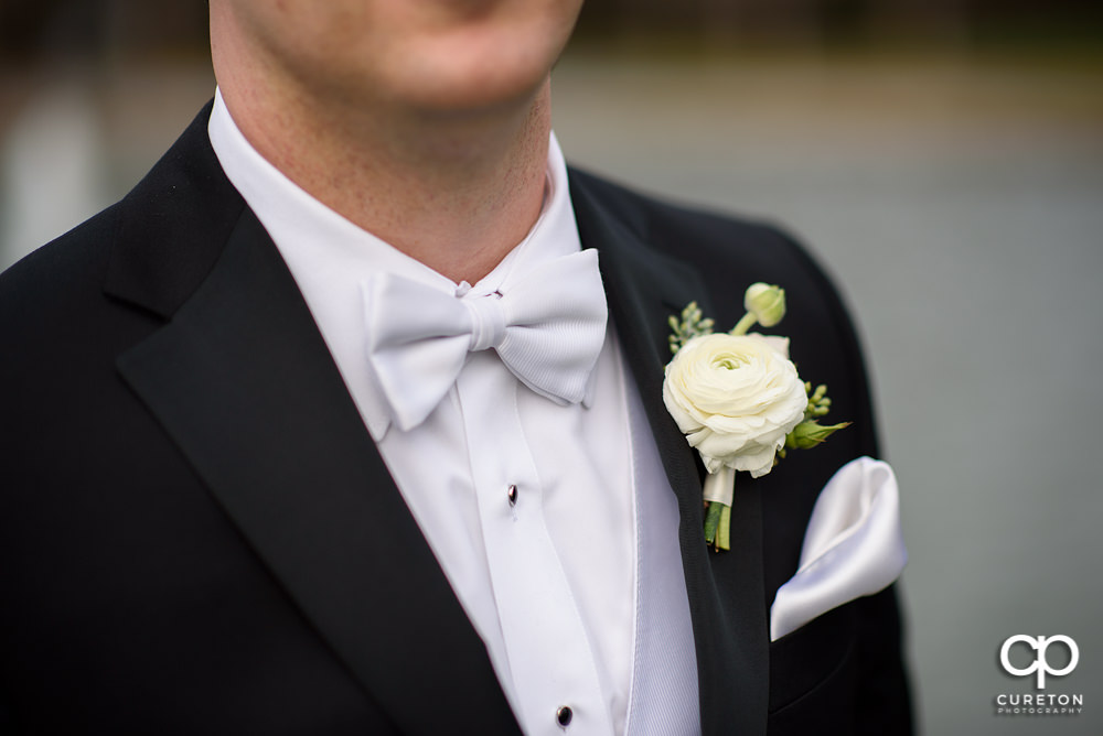 Groom's tie and flower.