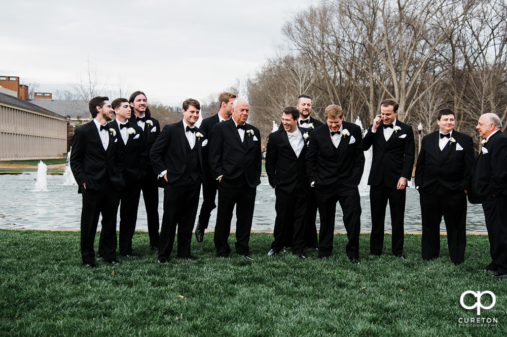 Groomsmen laughing.