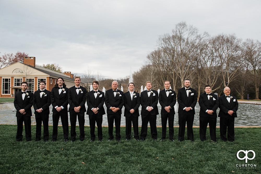Groomsmen in front of the fountain at Furman University.