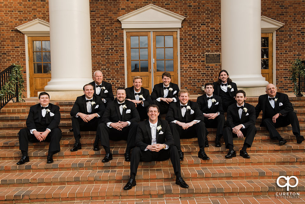Groomsmen hanging out on the steps at Daniel Chapel.