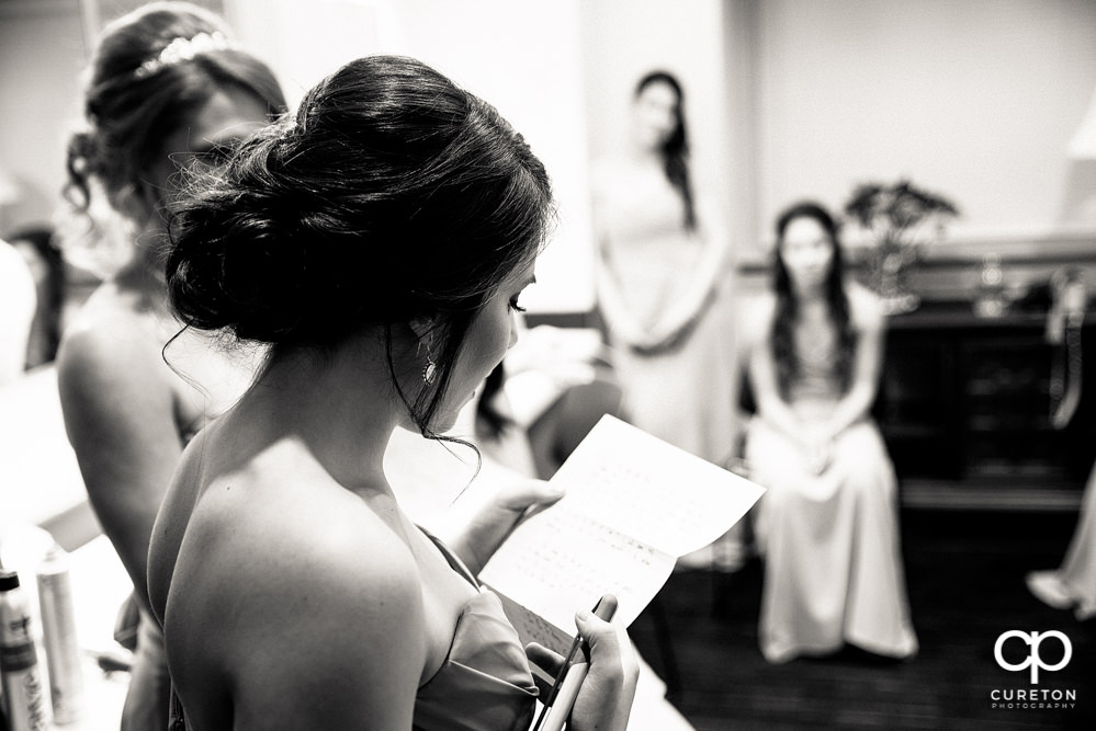 Bridesmaids reading a note.
