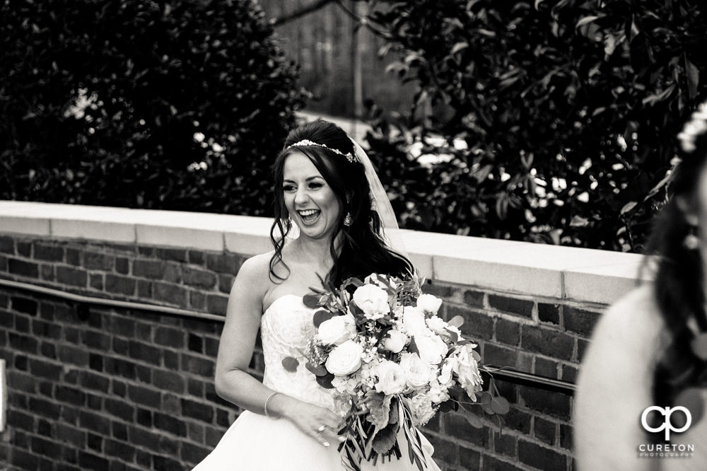Bride laughing before the wedding.