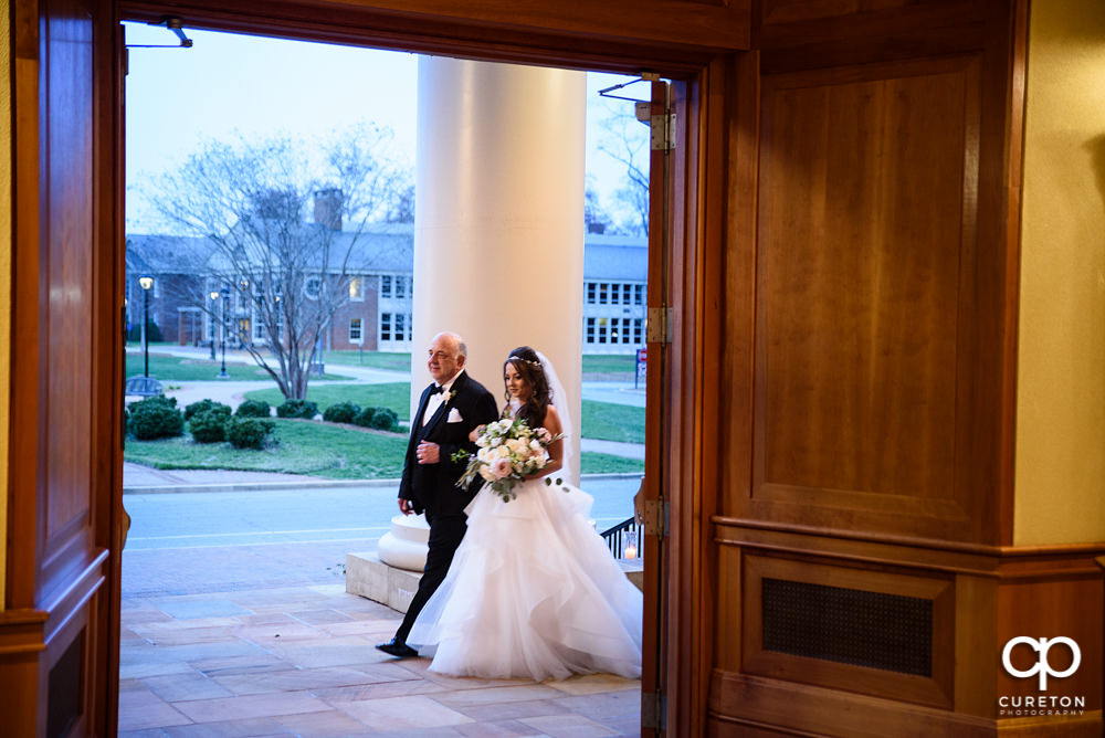 Bride and her father walking into the chapel.