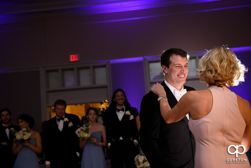 Groom dancing with his mother at the reception.
