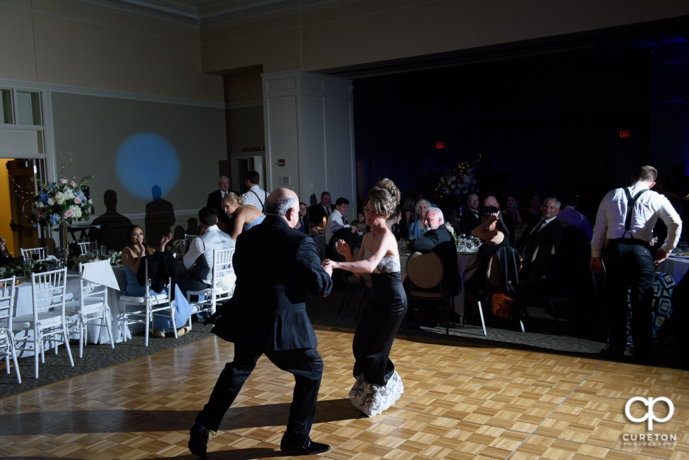 Bride's parent's dancing.