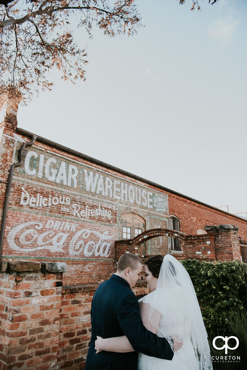 Bride and groom outside the Old Cigar Warehouse before their downtown Greenville wedding.