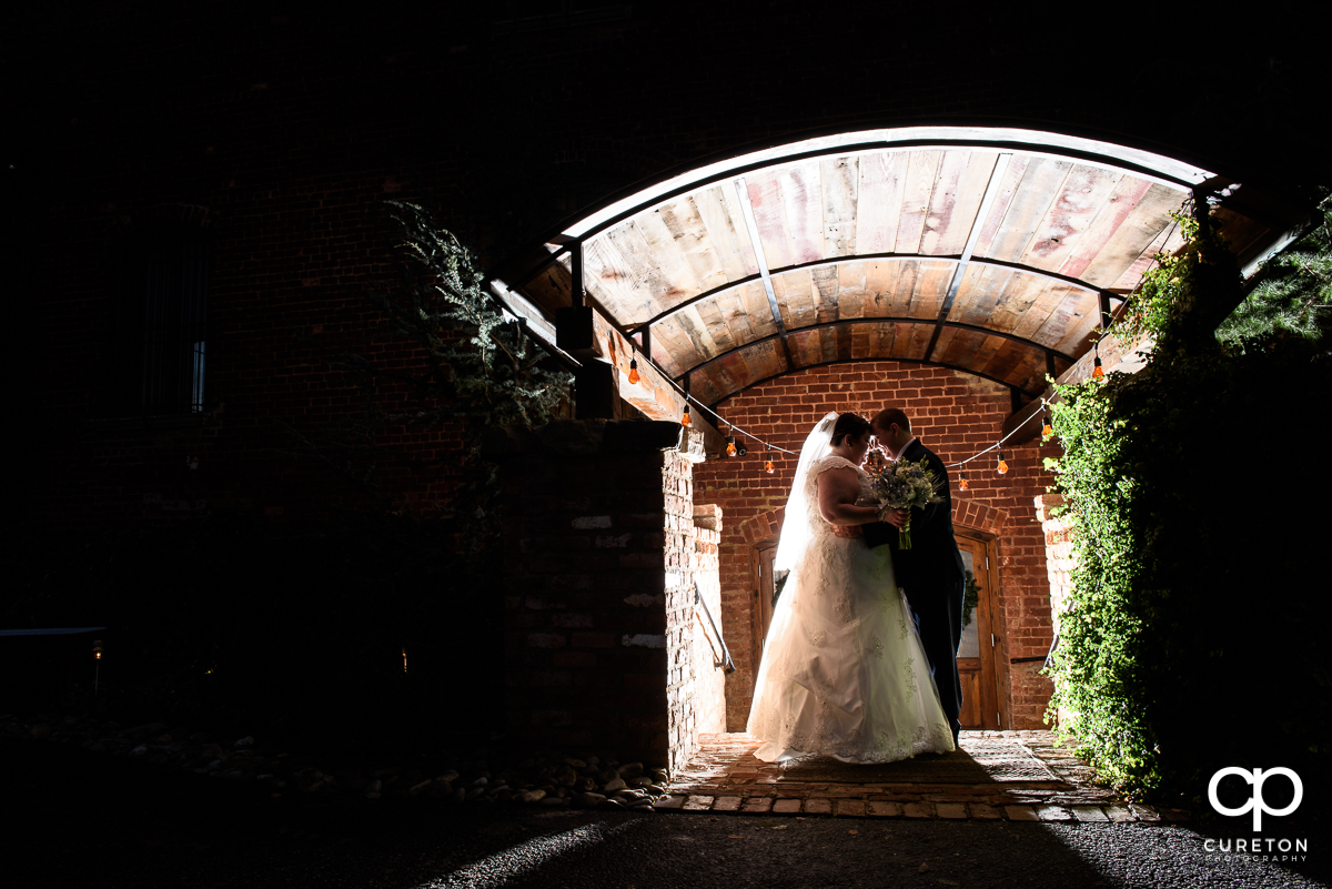 Creative photo of a bride and groom at The Old Cigar Warehouse.