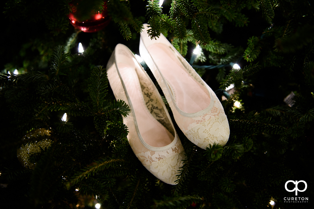 Brides shoes in a Christmas tree.