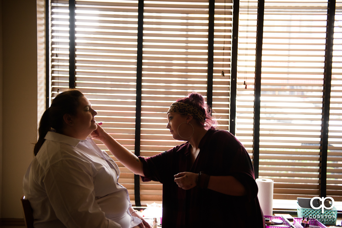 Bride getting her makeup up before her wedding at The Westin Poinsett hotel.