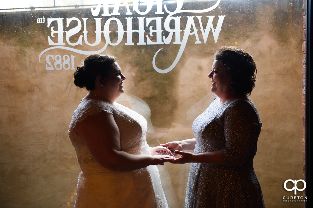 Bride and her mother having a quite moment before the wedding ceremony at The Old Cigar Warehouse.