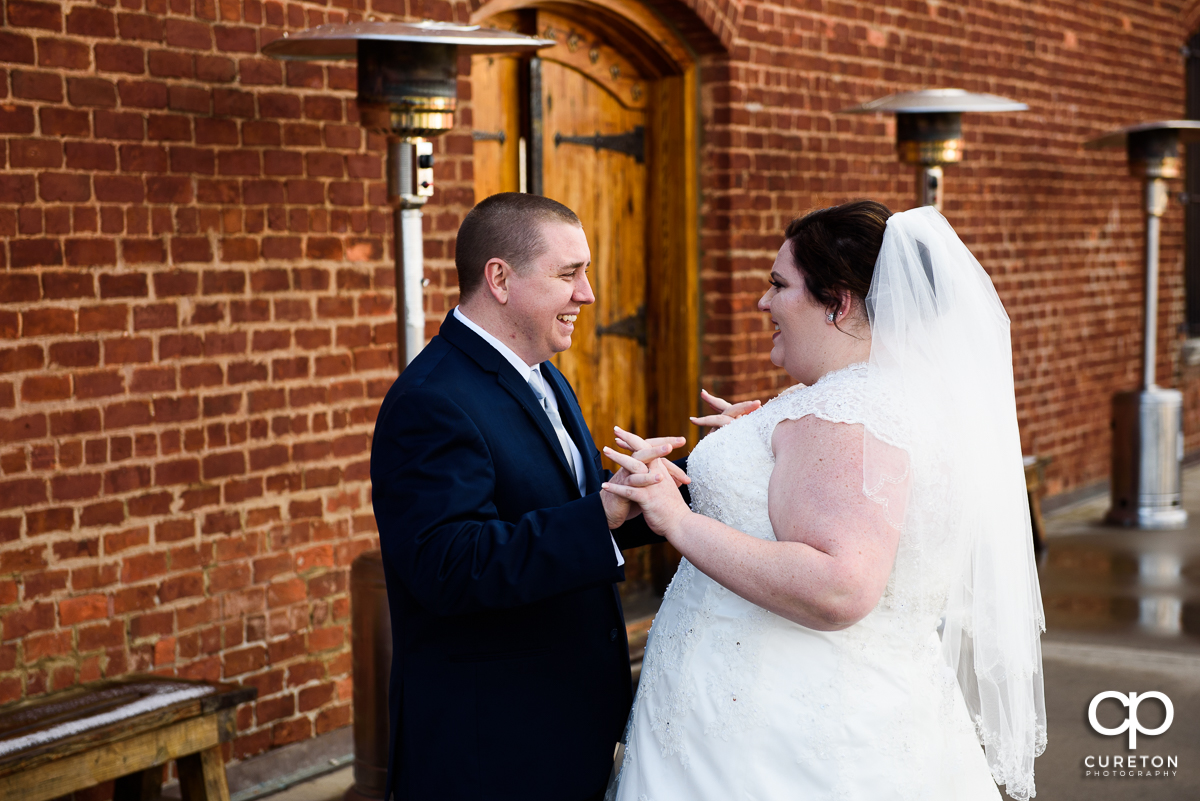 Groom getting emotional when he sees his bride for the first time.