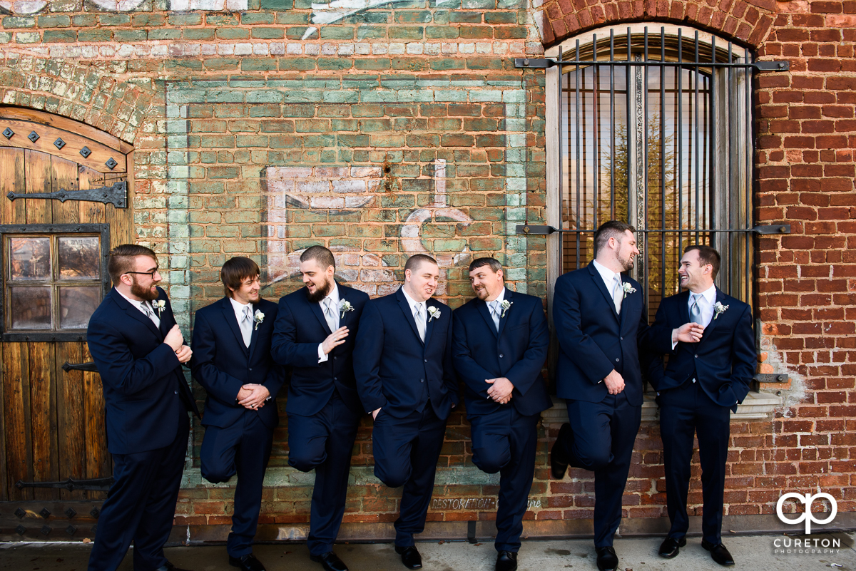 Groomsmen on the deck of the Old Cigar Warehouse.