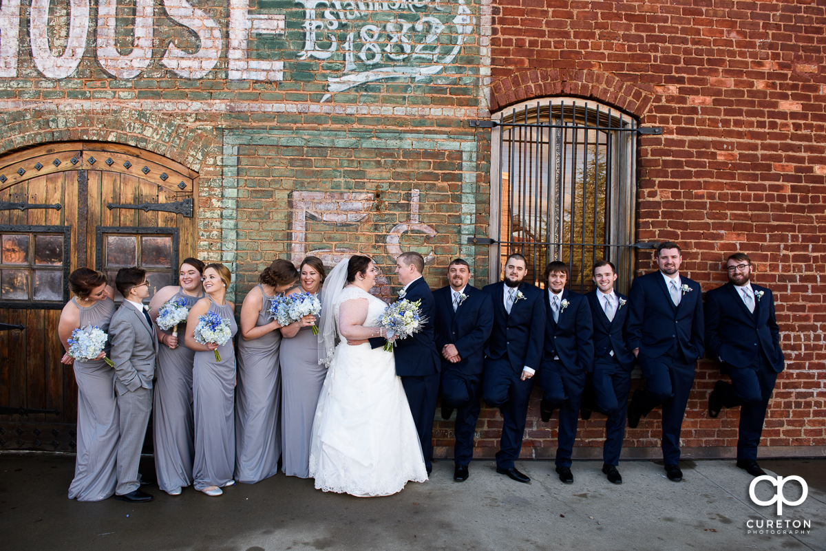 WEdding party having fun on the deck of The Old Cigar Warehouse.