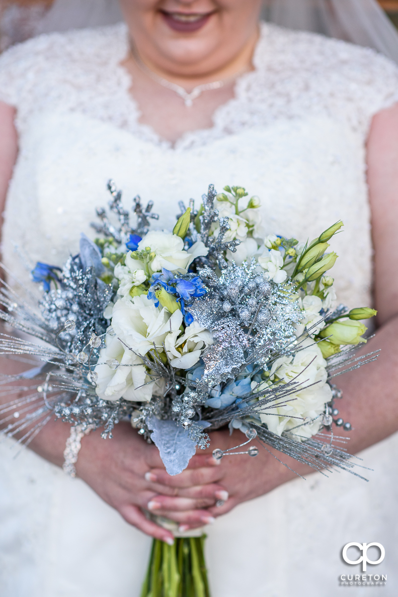 Gorgeous winter themed bridal bouquet by Renee Burroughs Design.