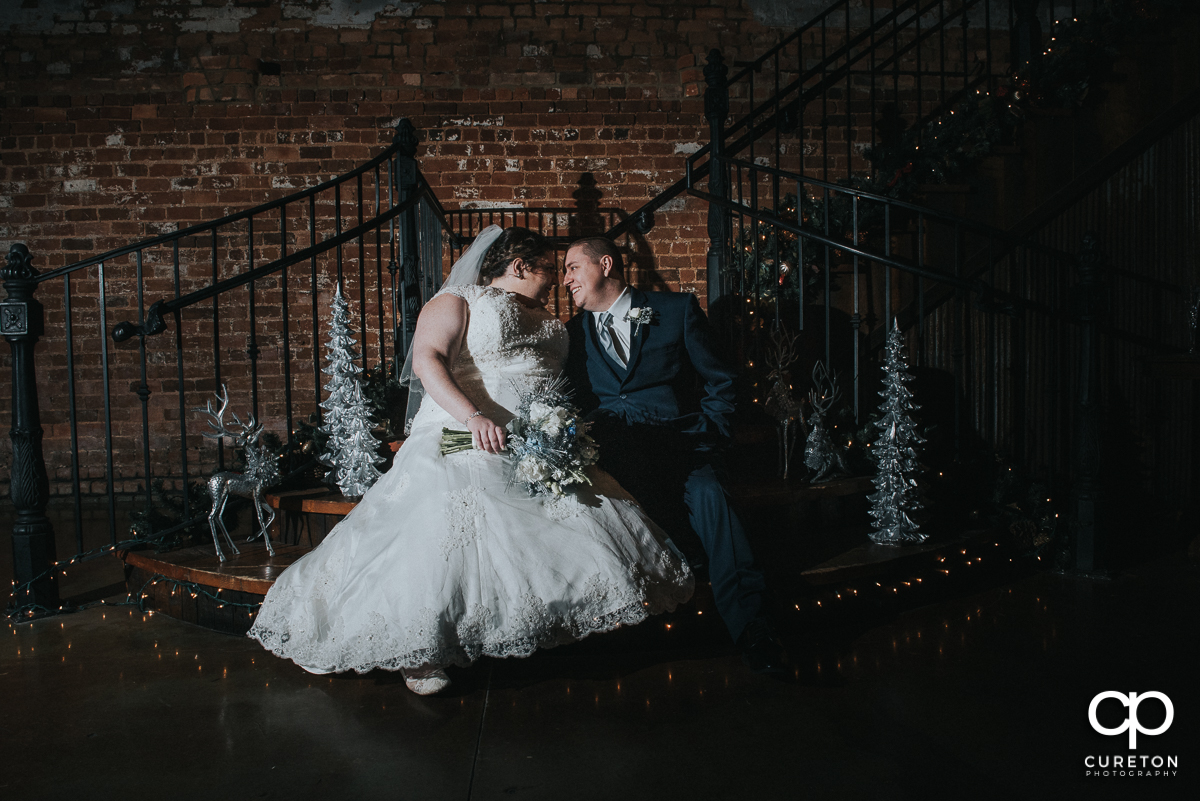 Bride and groom on the staircase at Old Cigar Warehouse.