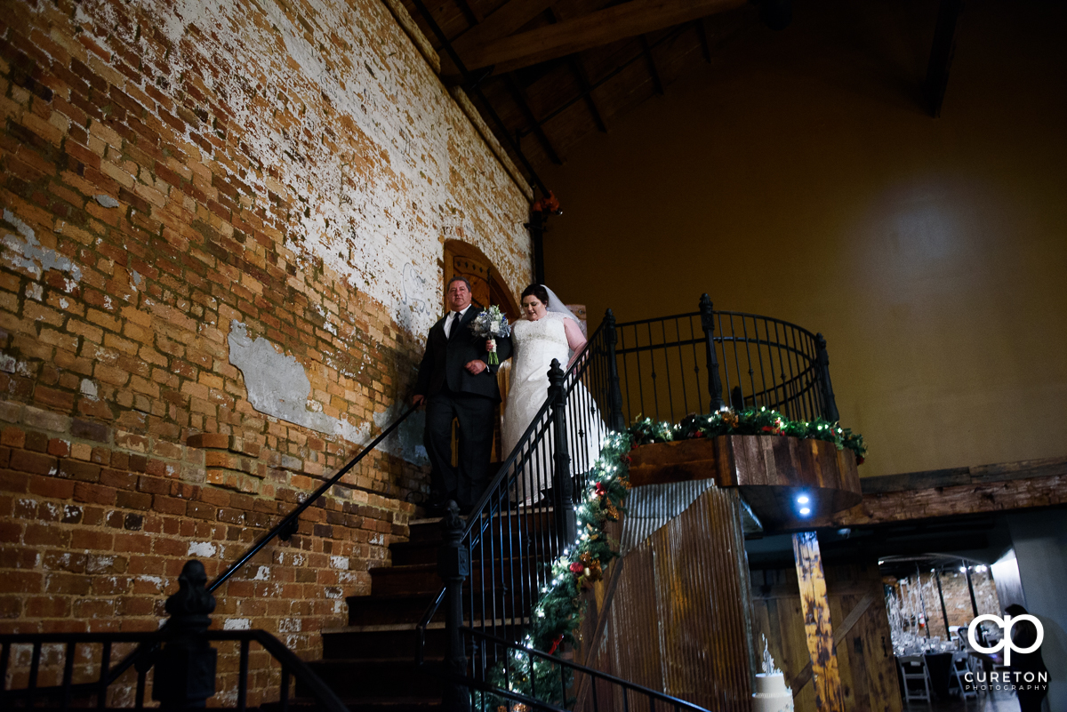 Bride making her grand entrance at her December Old Cigar Warehouse wedding.