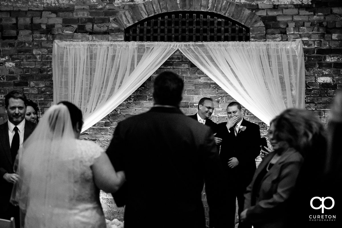 Groom crying when he sees his bride walking down the aisle for the first time.