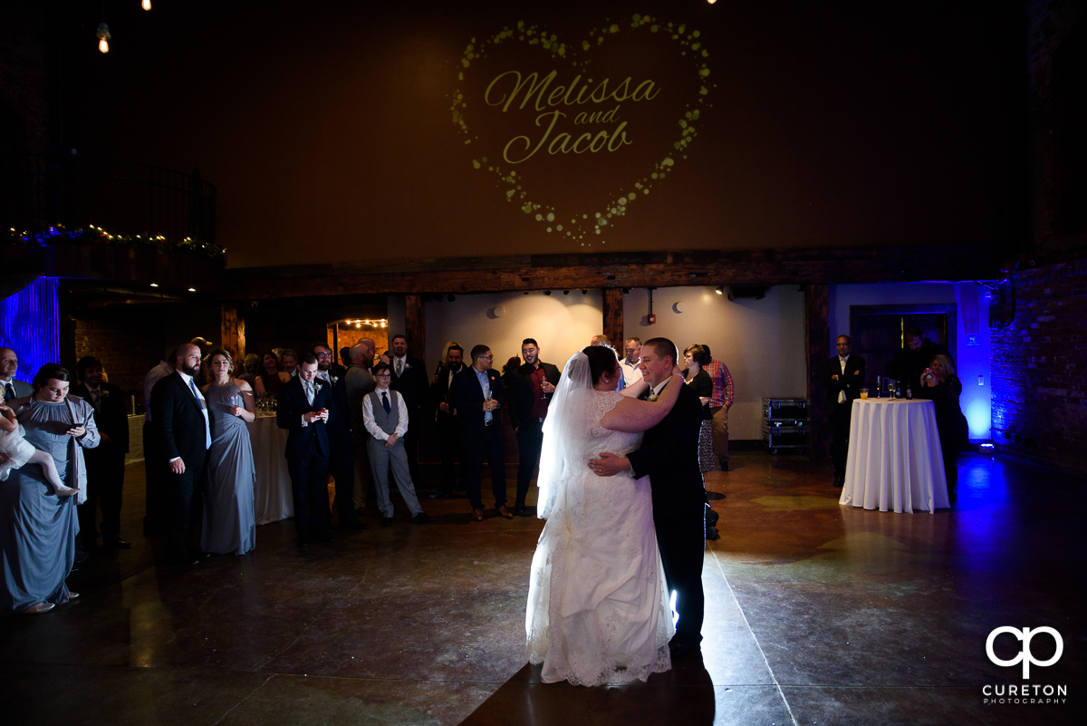 Bride and groom having a first dance at The Old Cigar Warehouse.