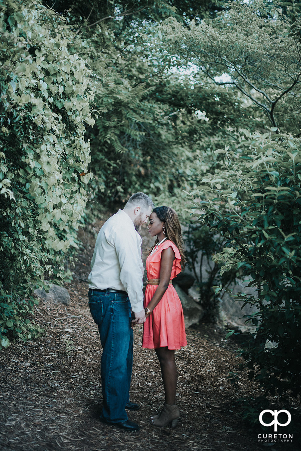 Bride and groom in a park in downtown Greenville.