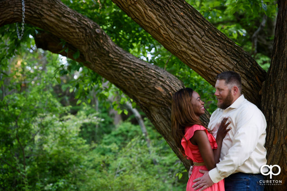 Engaged couple in a a downtown Greenville park.