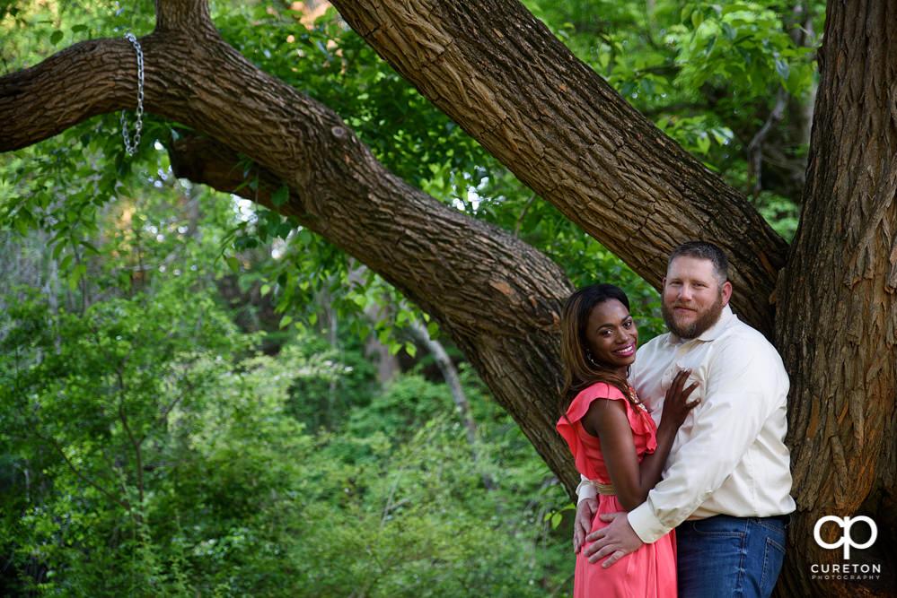 Bride and groom near an oak tree