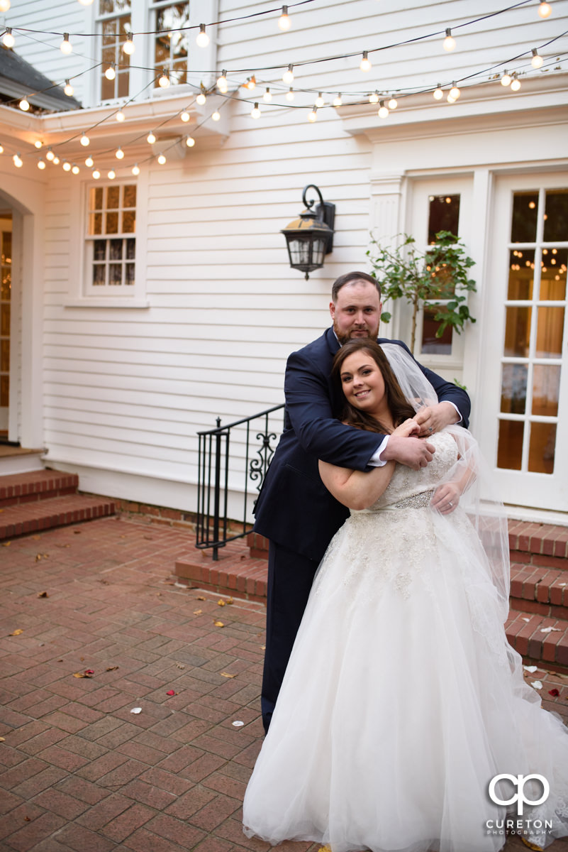 Groom holding his bride on the patio at their Duncan Estate wedding in Spartanburg,SC.