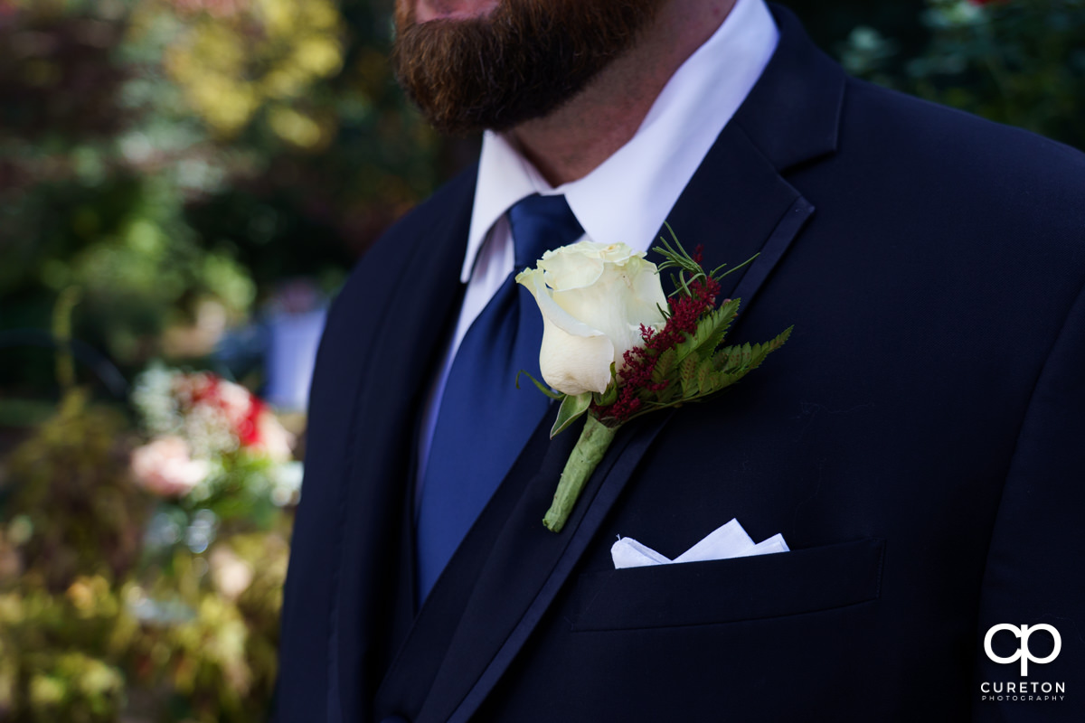 Grooms jacket and boutonniere.
