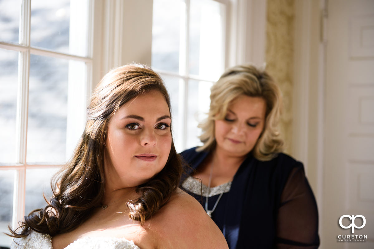 Bride getting ready with her mother.