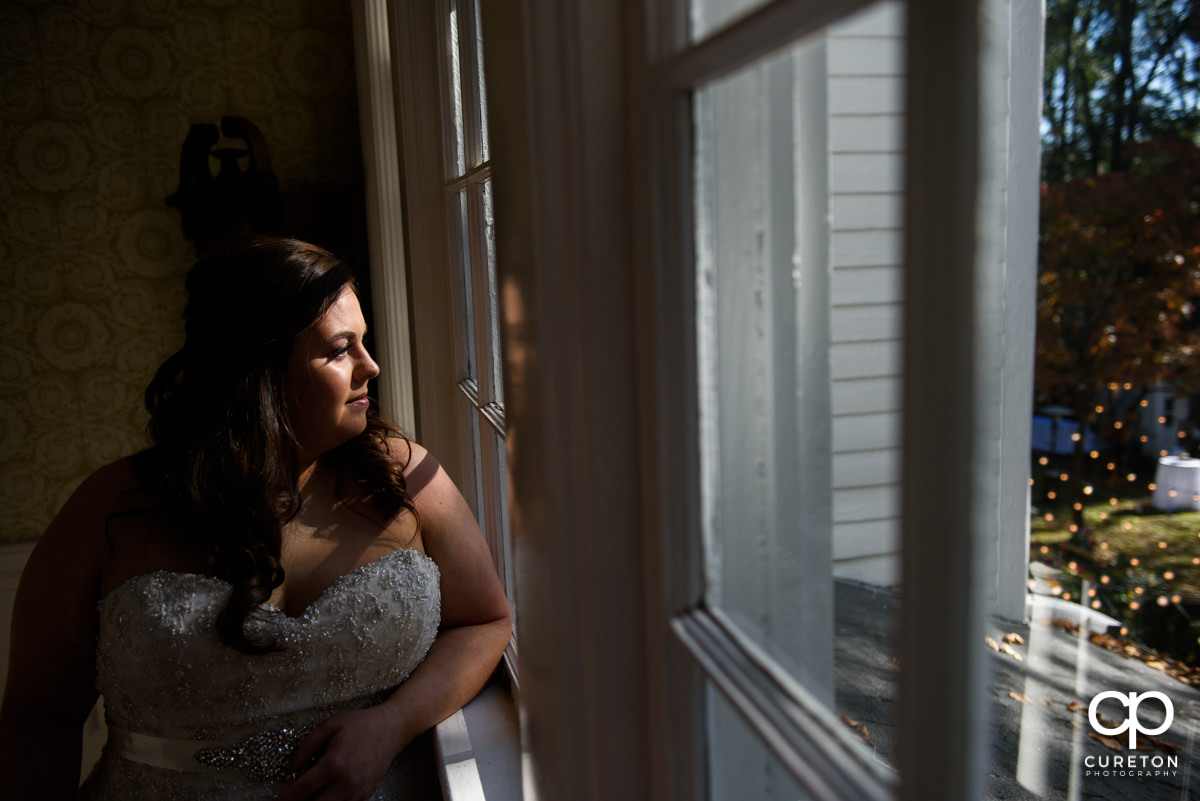 Bride looking out the window.