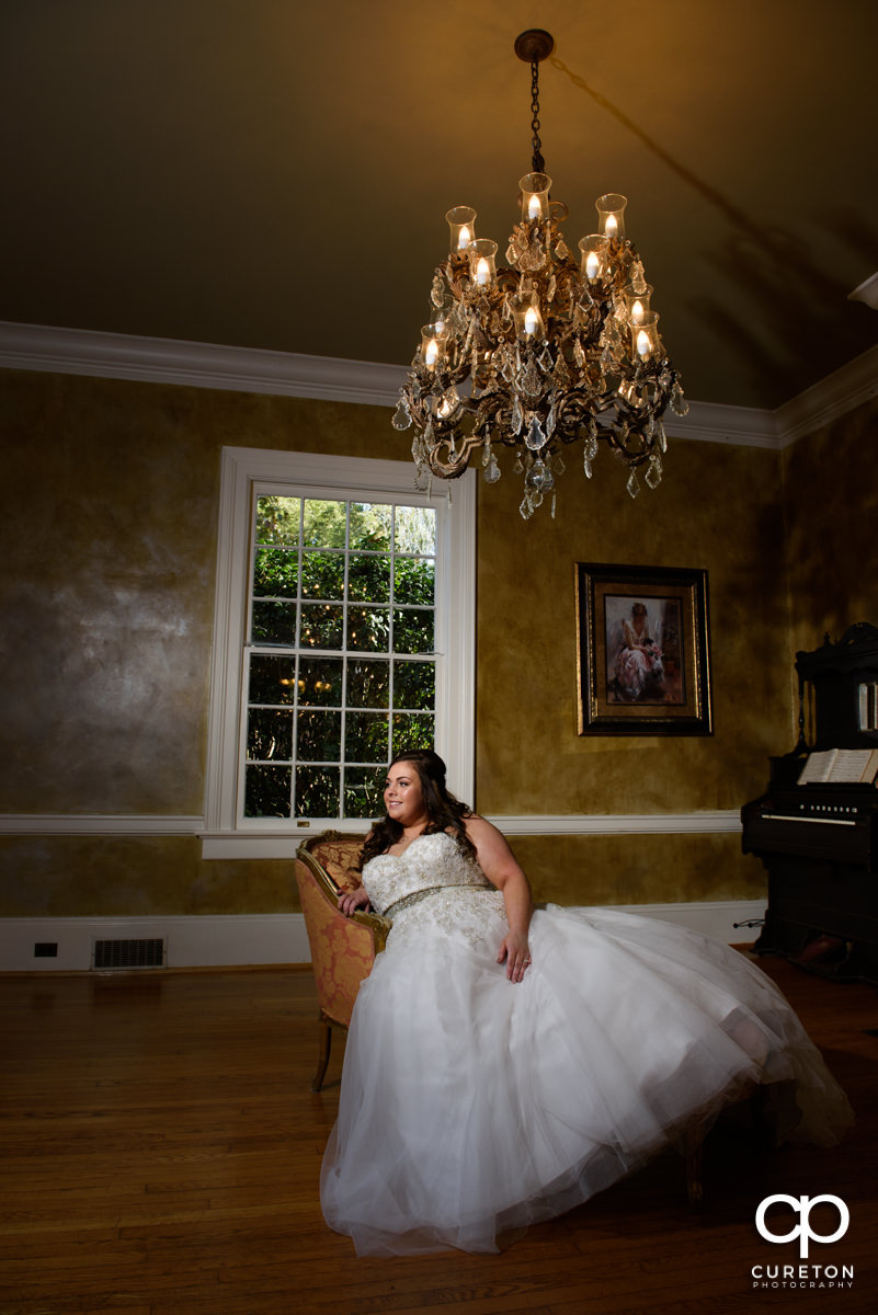 Bride sitting in on a fainting couch.