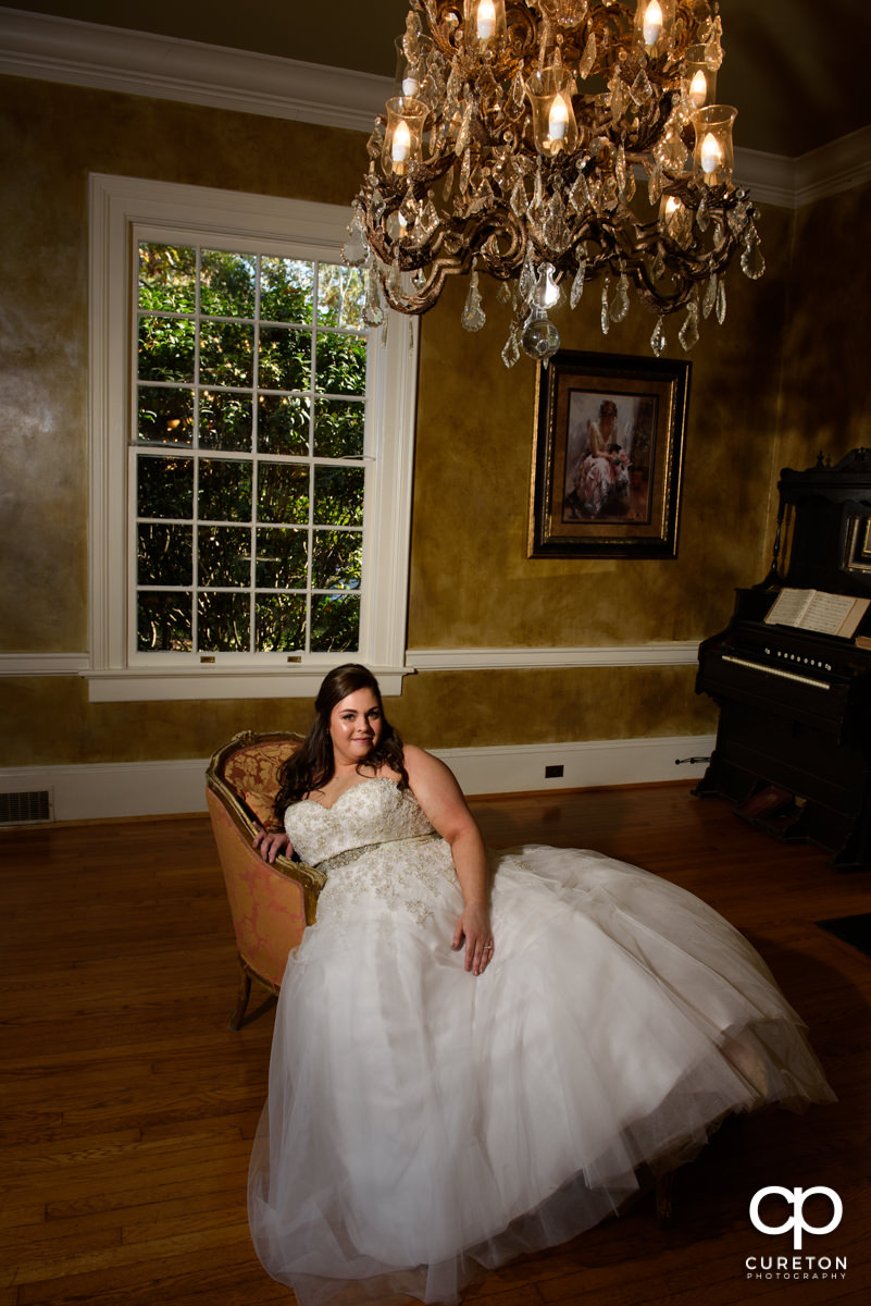 Bride sitting in on a fainting couch before her wedding at the Duncan Estate in Spartanburg,SC.