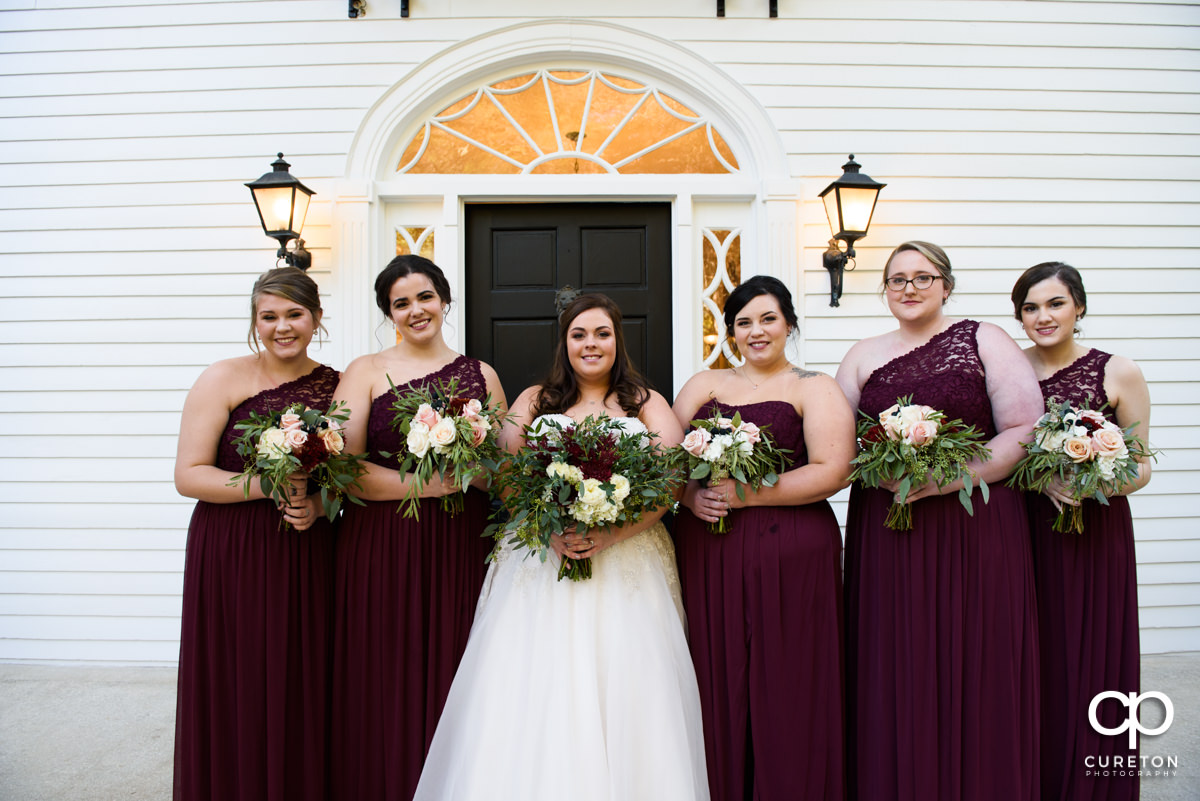 Bride and the bridesmaids standing in front of the house before the Duncan Estate wedding.
