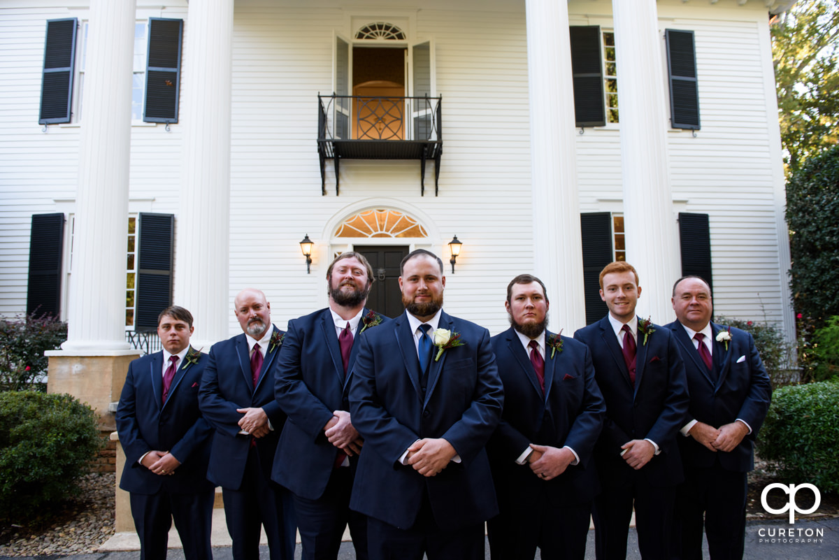Groom and groomsmen standing in front of the house before the Duncan Estate wedding.