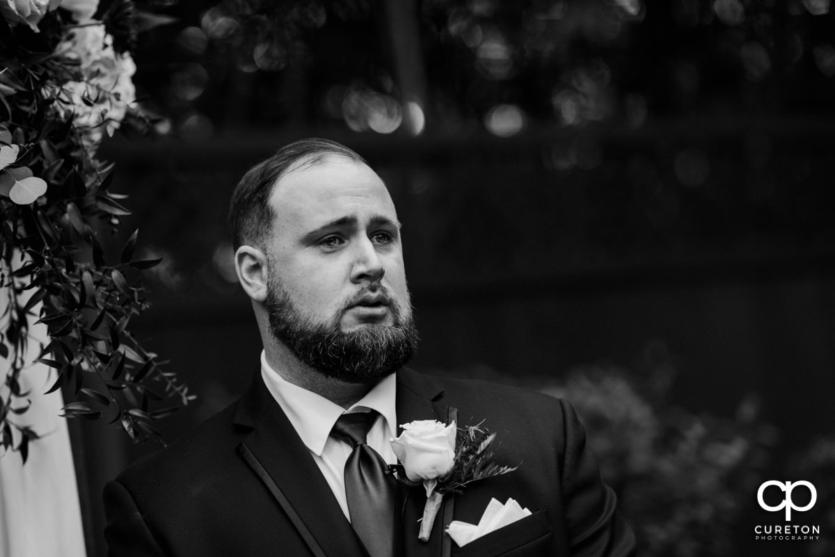 Groom tearing up as he sees his bride walking down the aisle at the Duncan Estate wedding in Spartanburg,SC.