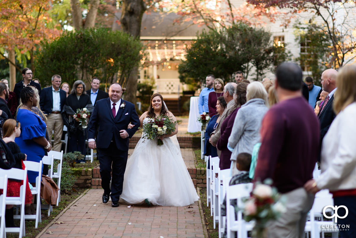 Bride walking down the aisle with her father at Duncan Estate.
