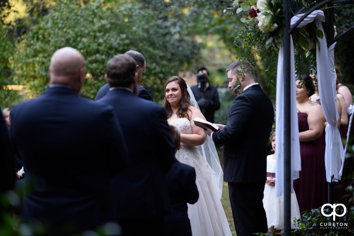 Bride smiling at her groom during the wedding ceremony at Duncan Estate in Spartanburg,SC.