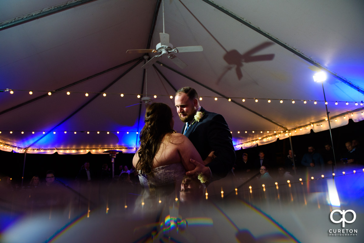 Bride and groom sharing a first dance at the Duncan Estate wedding reception.