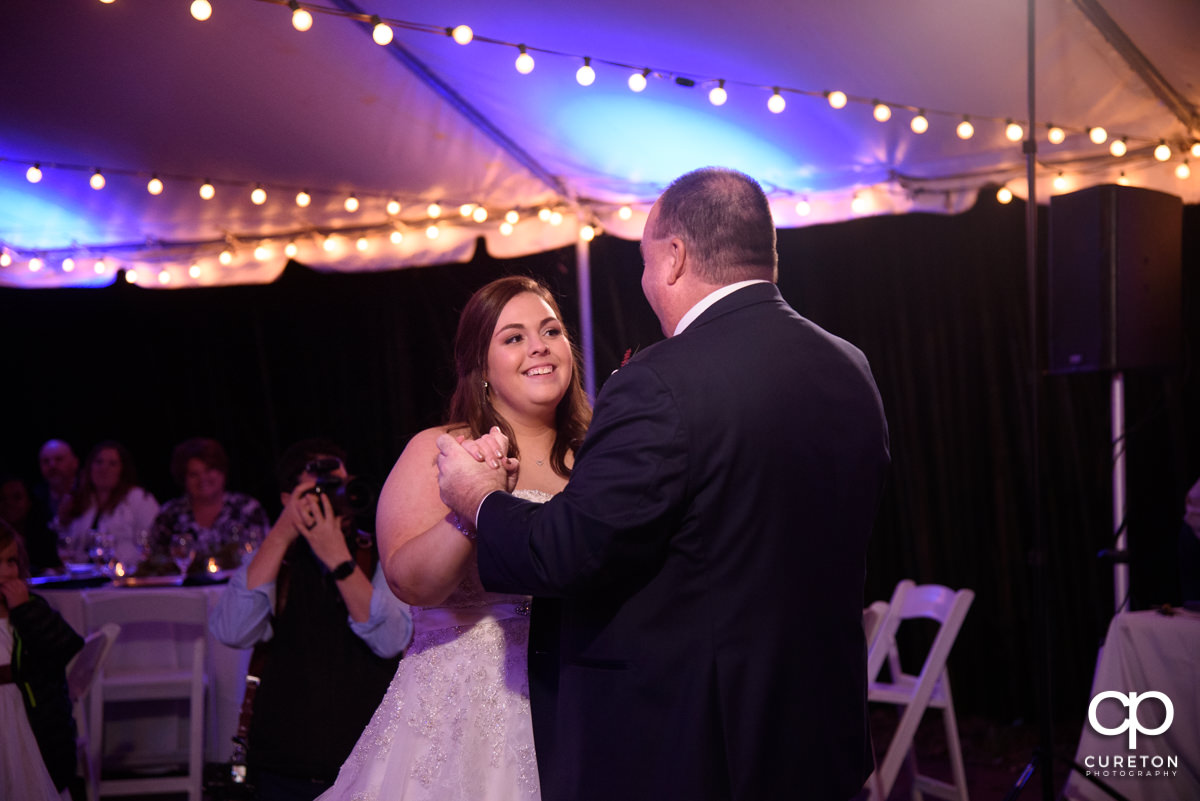 Bride dancing with her father at the Duncan Estate wedding reception.