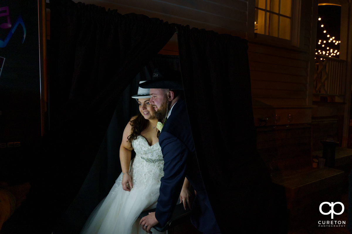 Groom and bride sharing a moment in the photo booth.