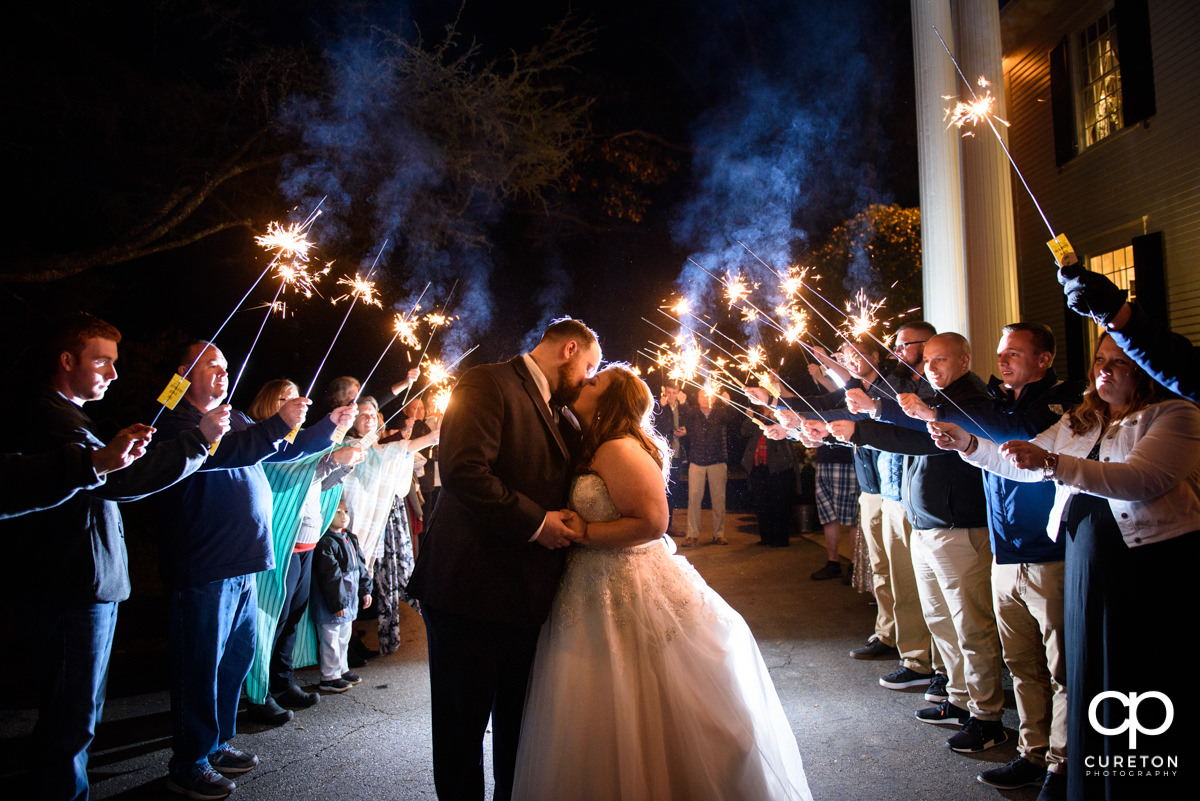 Bride and groom making an epic sparkler grand exit from the Duncan Estate wedding in Spartanburg,SC.