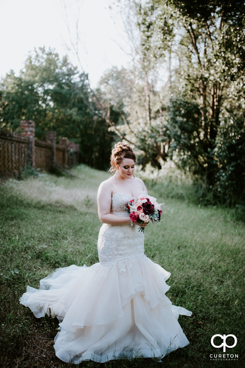 Bride in a field at Edinburgh West before her wedding.