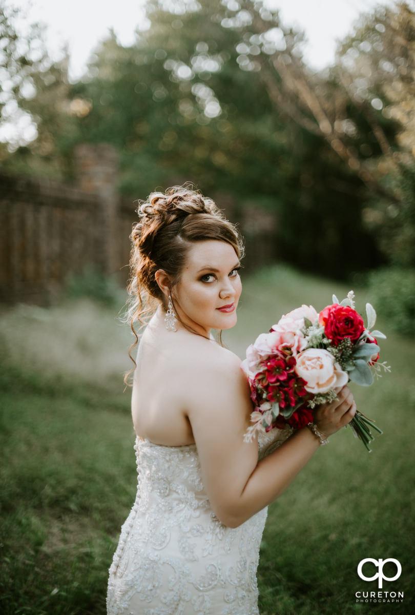 Bride holding her bouquet at Edinburgh West Wedding Venue in Taylors,SC.