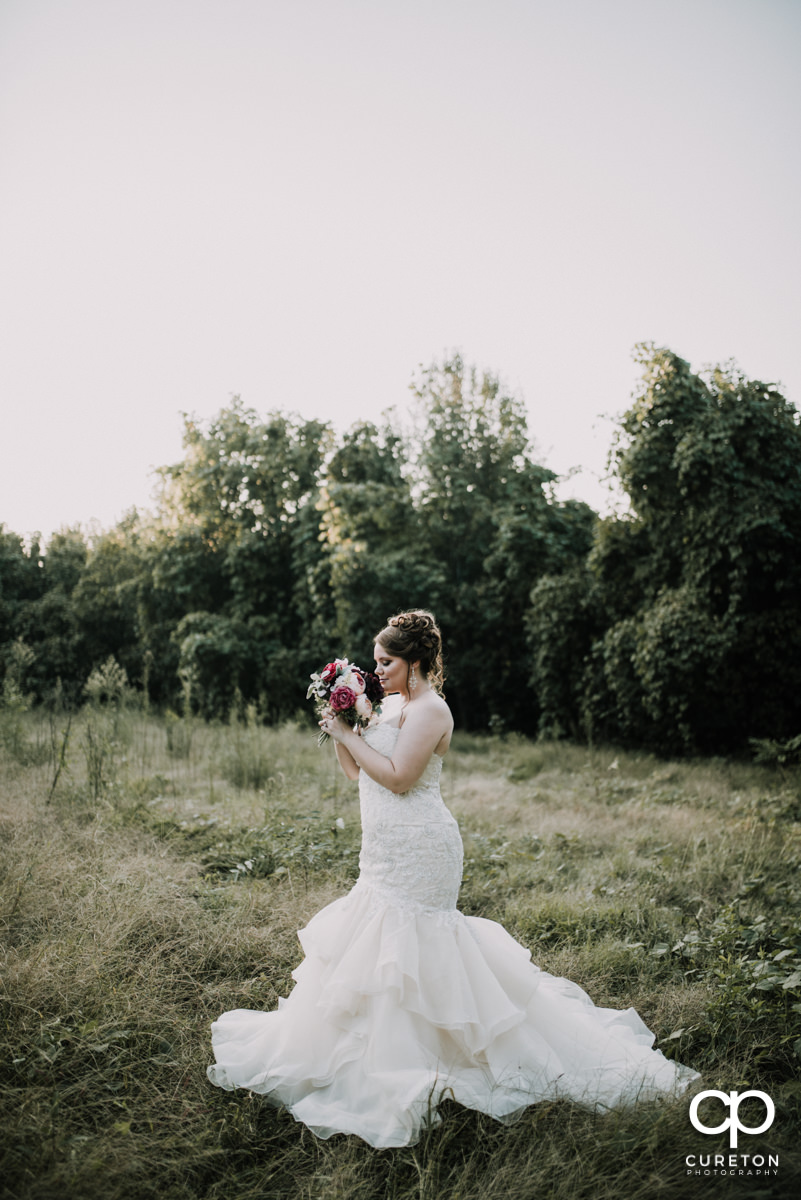 Bride in an overgrown meadow.