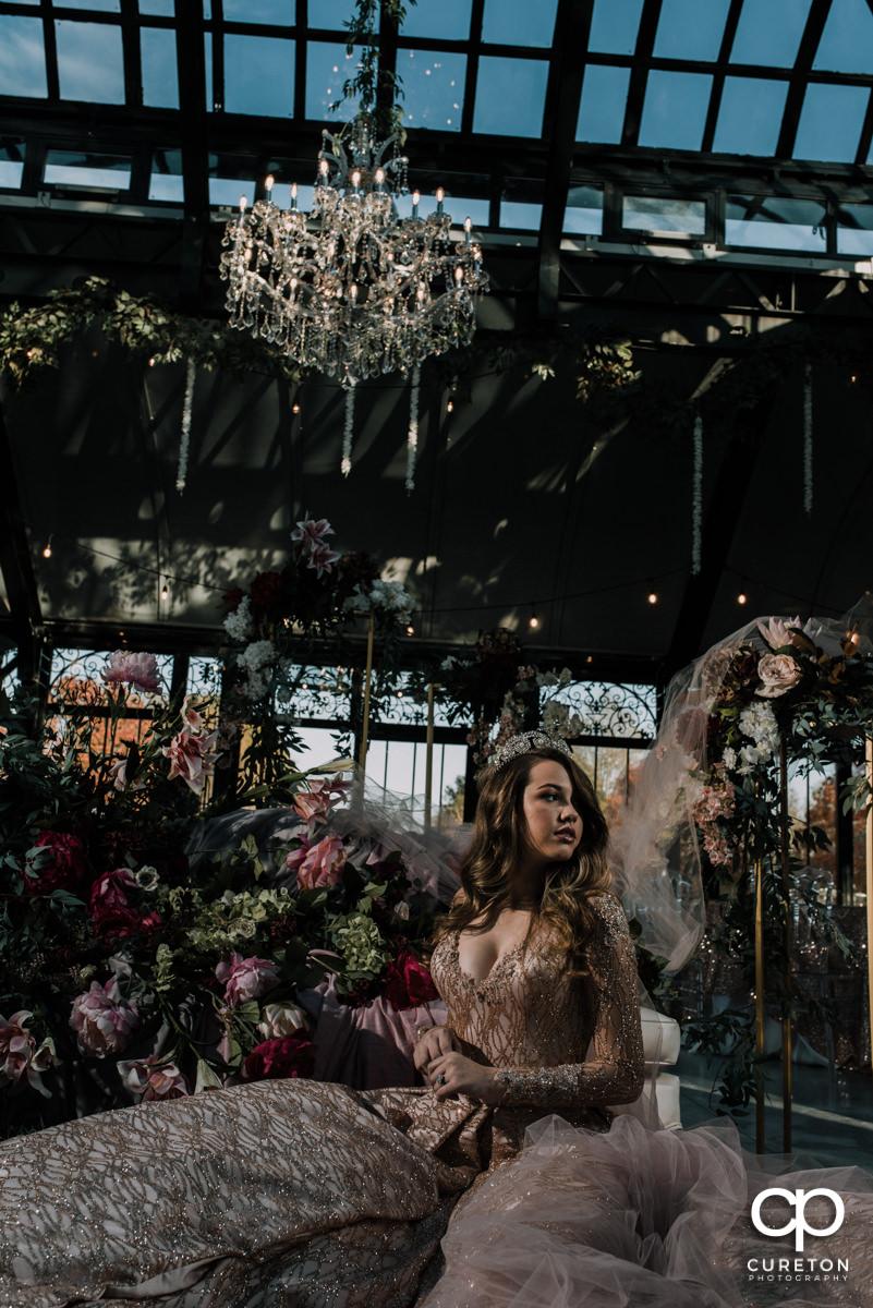 Bride in front of florals after her Edinburgh West wedding.