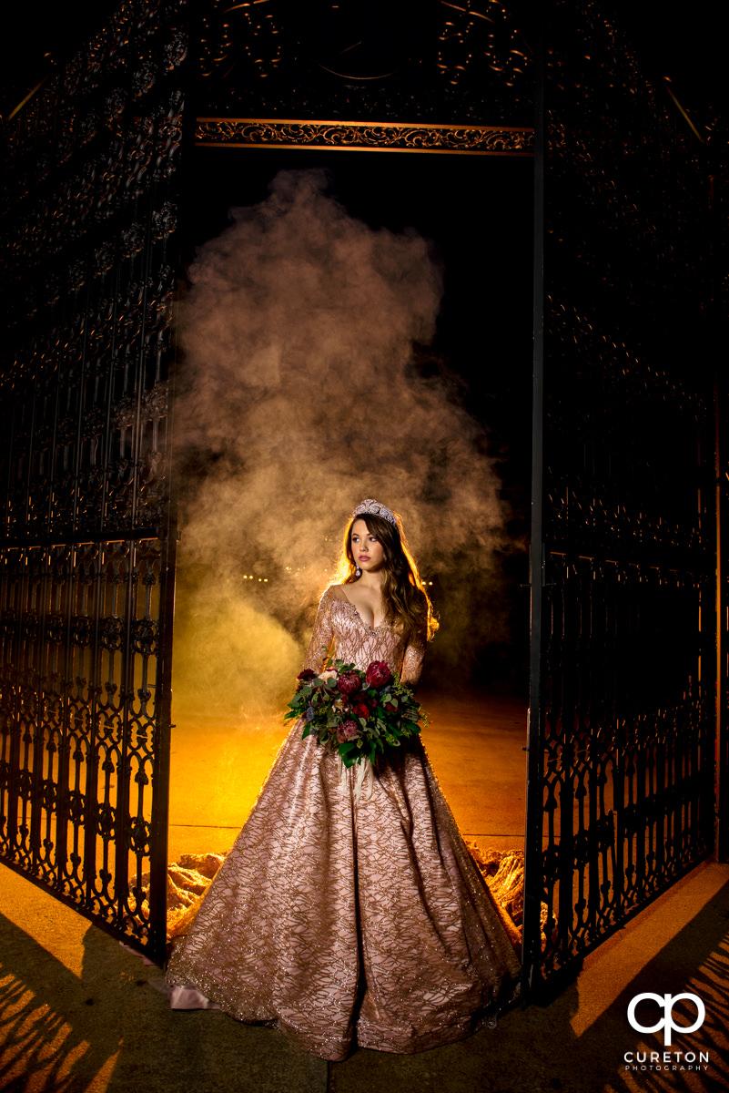 Bride at the gates at the Edinburgh West wedding venue.